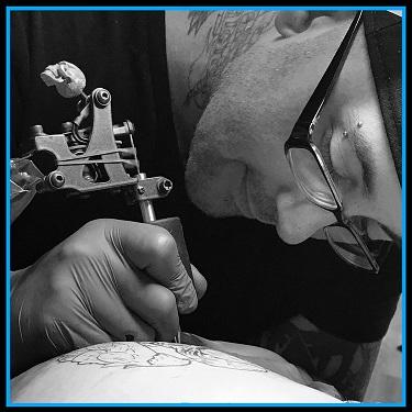 5eeeec731 paul+tattooing+for+website smaller.jpg