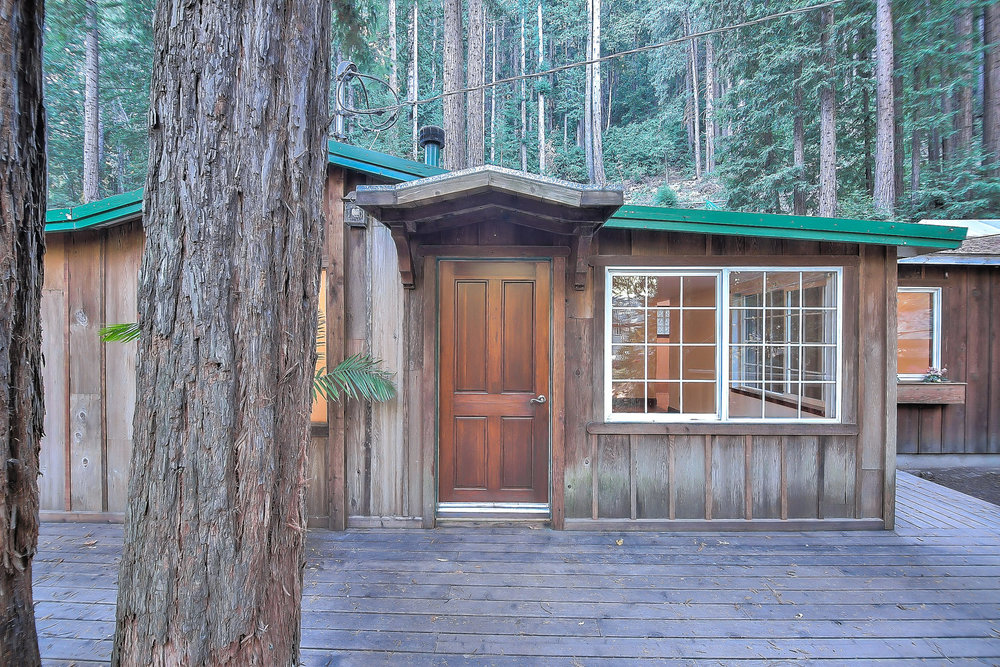 11033 Sequoia Ave. - Felton, California • Asking $545,0003 Beds • 2 Baths • 1245 SqftSoak in picturesque views of inspiring old-growth redwood trees on your deck that wraps around the entire exterior of the home. This single story home in the Santa Cruz Mountains features a dual fireplace to cozy up to on crisp fall days, stone bathrooms & hardwood floors. Skylights throughout provide lovely natural light. A storage shed in the yard provides extra space, perfect for gardening in the front beds. The Loch Lomond recreation area is just 2 minutes up the road & offers kayaking, fishing & hiking.