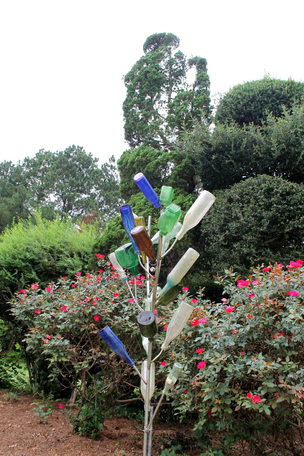 A glass bottle tree at Pearl Fryar's Topiary Garden.