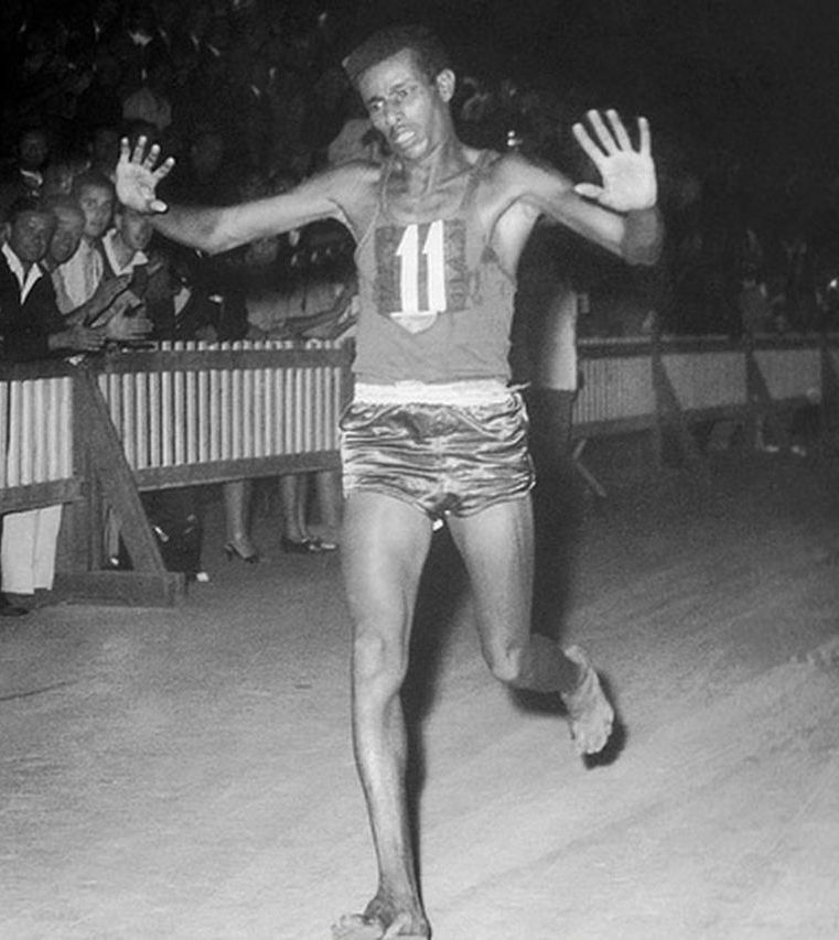 Abebe Bikila winning gold in Rome, 1960.