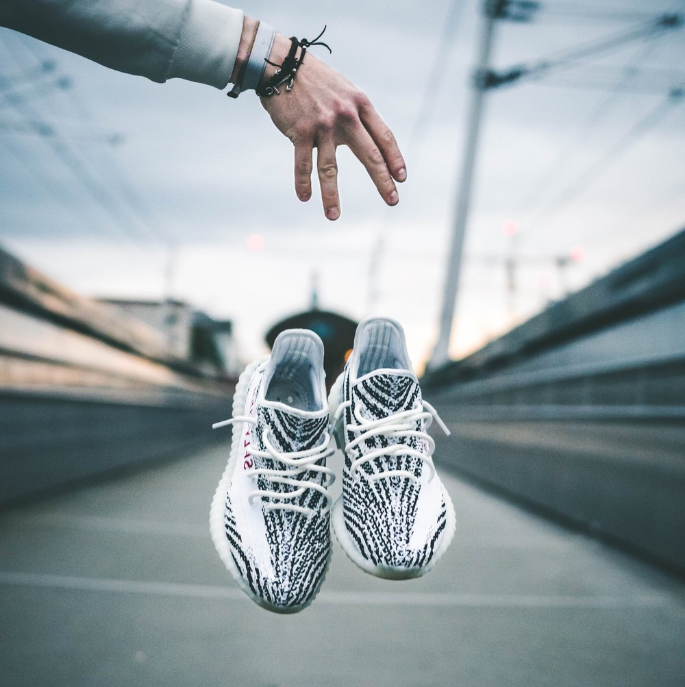 A 2016 report from Organization for Economic Cooperation and Development lists footwear as the #1 counterfeited product and Yeezys is one of the most popular shoe line being counterfeited. // Image: Greg T / Unsplash