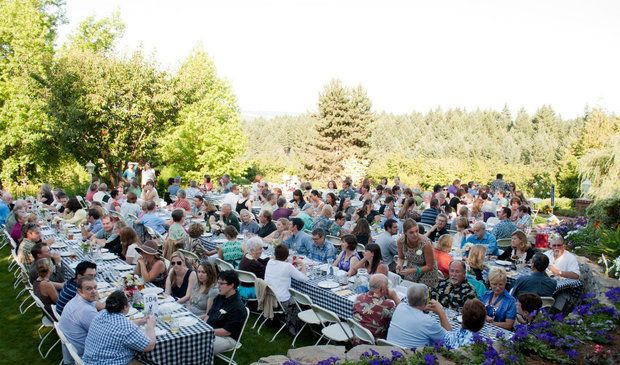 Attendees of the 2012 FarmPlate dinner gather to share plates of locally grown food, prepared by Chef Pascal Chureau, of West Linn's Allium Bistro.  (Rissa Ochs)