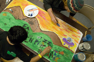 Johnson, HomePlate's volunteer art coordinator (above) works on one of two art tiles for Earth Oven Pizza with a HomePlate youth on one of the two art tiles for Earth Oven Pizza. HomePlate in Hillsboro helps homeless youth in the area. The HomePlate art tiles will become a mural for the ceiling of the pizza restaurant. Photo by Michal Thompson / The ArgusRobin