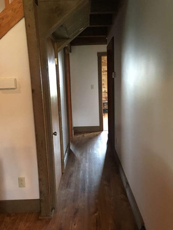 hallway leading into 1st floor bedrooms and full bath