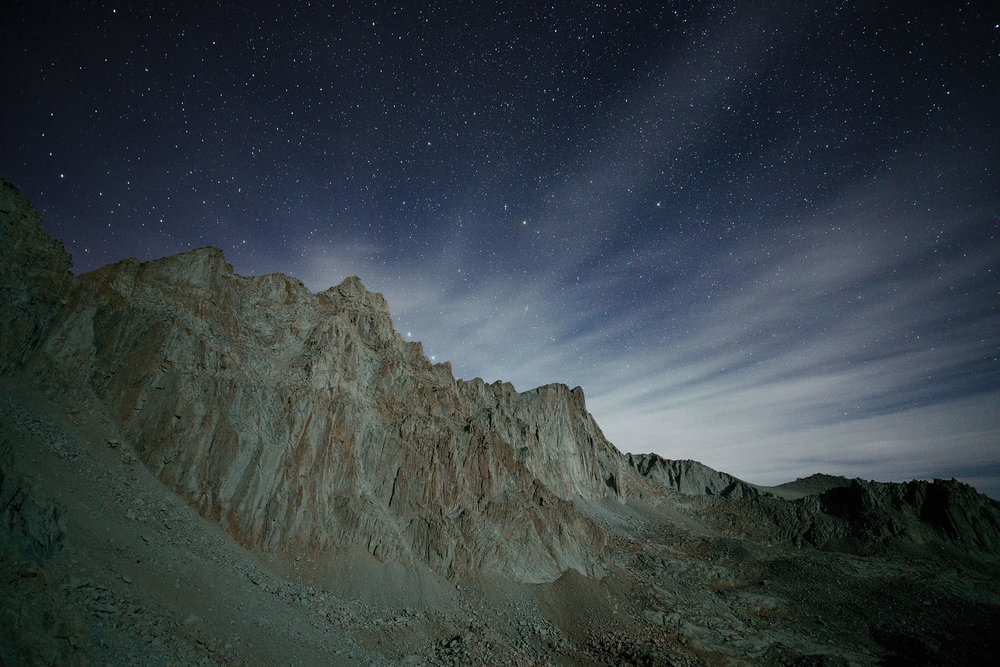 Mt. Whitney illuminated by a partially eclipsed moon during our final descent from the trail