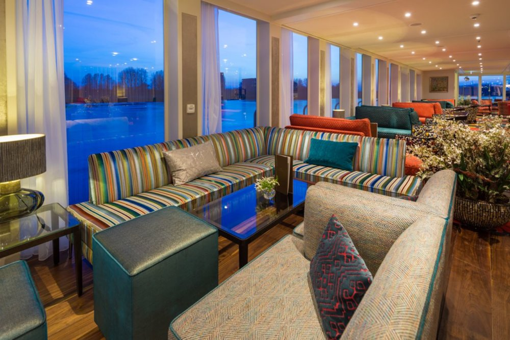 Panoramic lounge with bar; piano and dance floor; and Observation Lounge