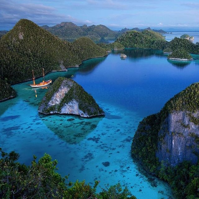 "This is one of Raja Ampat's most spectacular spots, perfectly summed up by a recent guest onboard one of our luxury private phinisi yachts; ""The Wayag islands were possibly the most breathtaking place we have ever seen. We felt they were ours for 3 days, just the occasional local boat whizzed by. The diving was sublime and the fireflies celestial, lighting all the hills in a pounding rhythm of light. We kayaked for hours in the lagoons never seeing a soul. This was beyond any dream and a once in a lifetime experience."" • • • #indonesia #rajaampat #wayag #luxurytravel #travel #sea #landscapephotography #sunset  #privatetravel #island #asia #luxury #sailing #yacht #phinisi #escape #yachting #wanderlust #traveldeeper #discover #honeymoon #beach #ocean #adventure #wilderness #underwater #diving"
