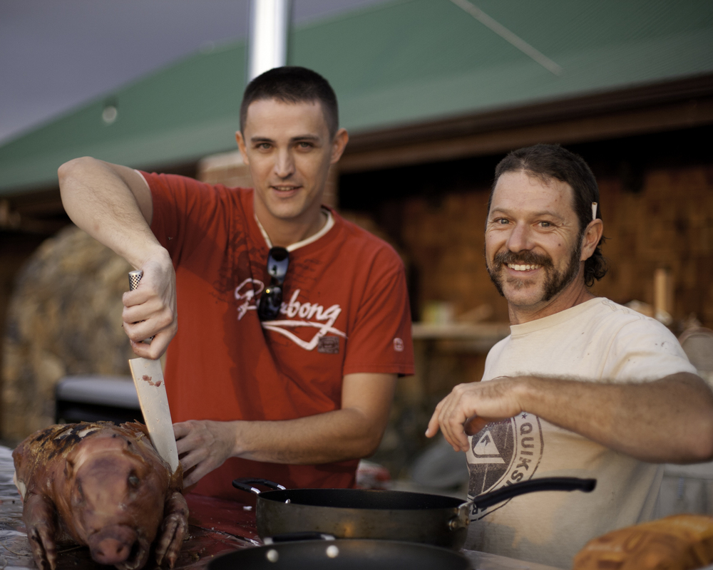 Scott and Ryan carving the pig