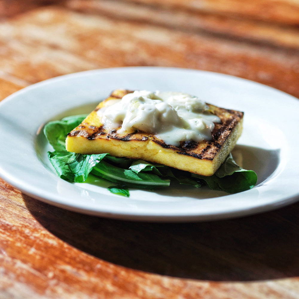 Grilled Polenta and Gorgonzola Over Arugula