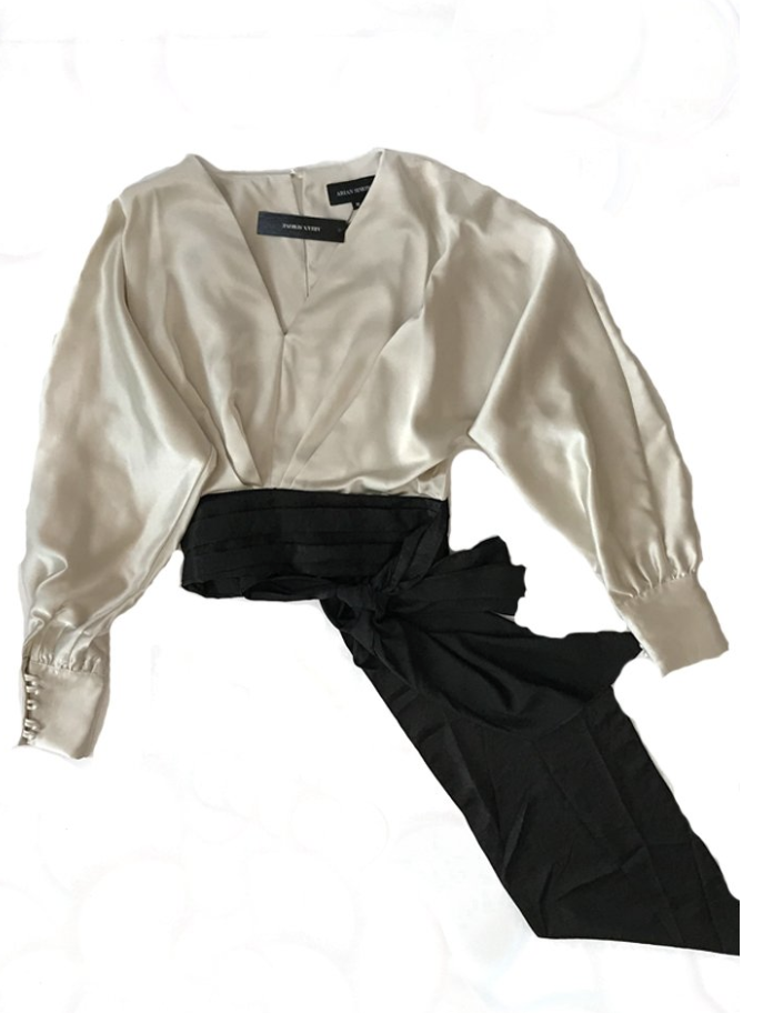 - Ivory Satin Blouse - Adding a statement like a bow or a belt can give your outfit some much-needed flair. This is a classy top that would pair well with any skirt or pants. This blouse retails for $133. Click here to purchase this product.