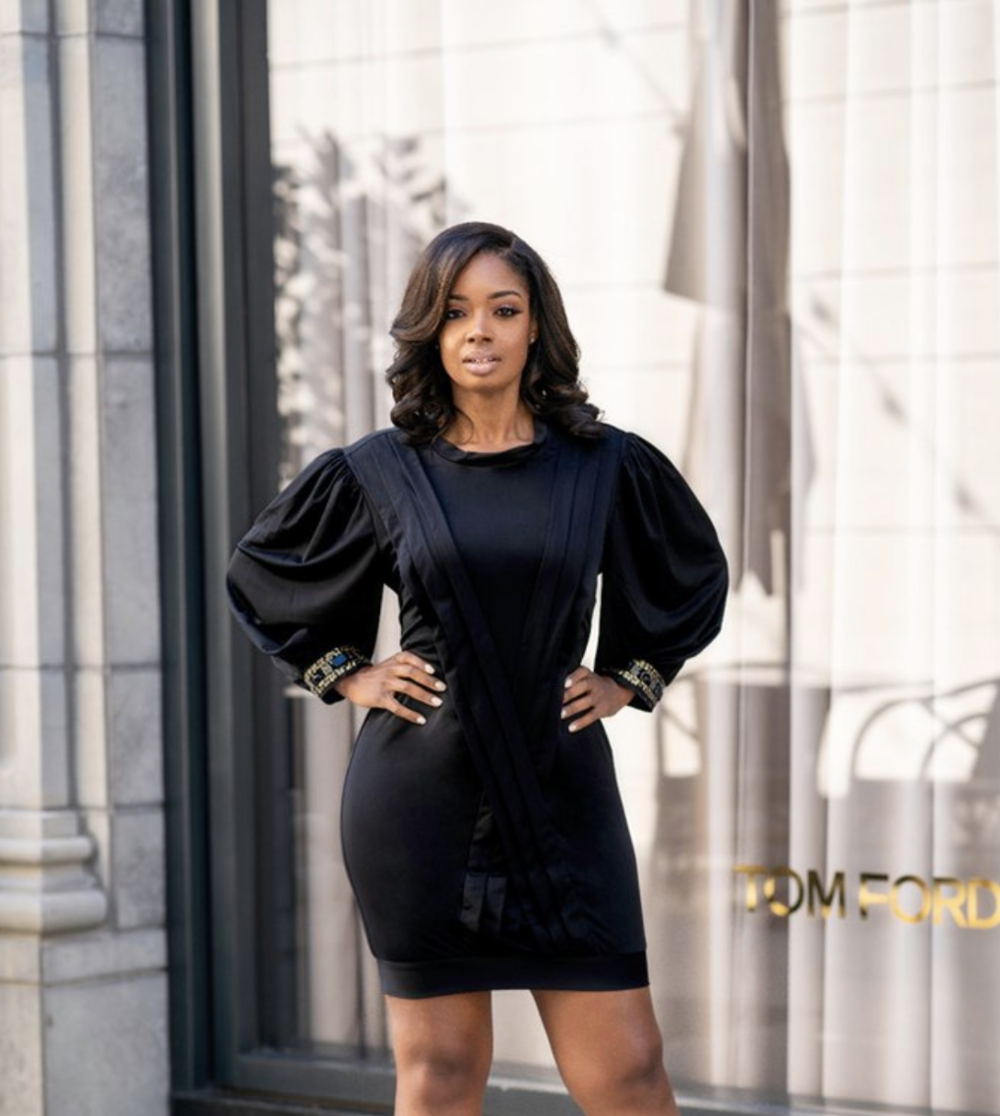 - Black Dress - Adding an embellishment to a collar or a sleeve is a nice way to spice up a simple look. This is not your average black dress. The exaggerated sleeves and embellished cuffs make this dress a show stopper. This dress retails for $124. Click here to purchase this product.