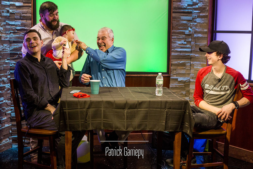 """""""Talk Show"""" Host RJ Sheedy, """"That Milford Show"""" Host Al Correia and volunteer Malcolm Zale share an on-air interaction with Milford TV Producer Mike Spurling and his daughter."""