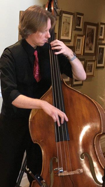 Sam montooth - Sam Montooth is a bassist and vocalist who lives right on the midpoint between Los Angeles and Orange Counties. Sam has been an in demand sideman for well over a decade and has worked with some of the best musicians Southern California has to offer as well as leading his own groups singing his original jazz music. He has traveled the world playing jazz, but is happiest playing with his friends here in Southern California. Sam is also a strong believer in music education and teaches a private studio as well as being a sought after string orchestra and jazz band clinician.