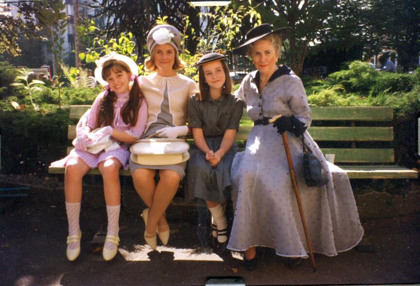 on bench with 2 kids and mother in old dress.jpg