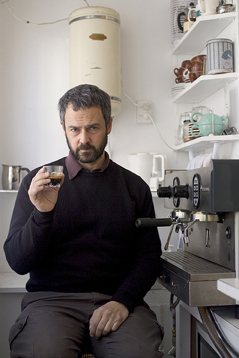Portrait of James Gilberd from Photospace holding an expresso.