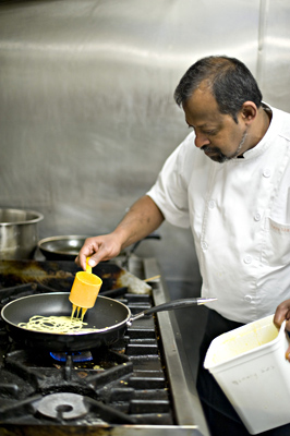 Rahja Vellasamy cooking Roti Jala in Wellington, New Zealand.