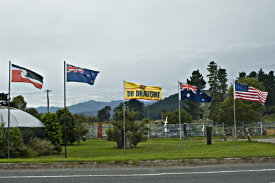 Line up of National Flags uncluding a DB Draught flag in New Zealand..