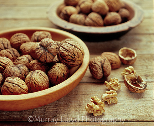 Walnuts in photographed in wooden bowl in studio