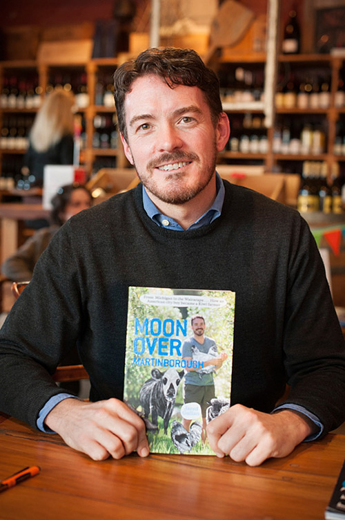 Jared Gulian with his newly published book Moon over Martinborough.
