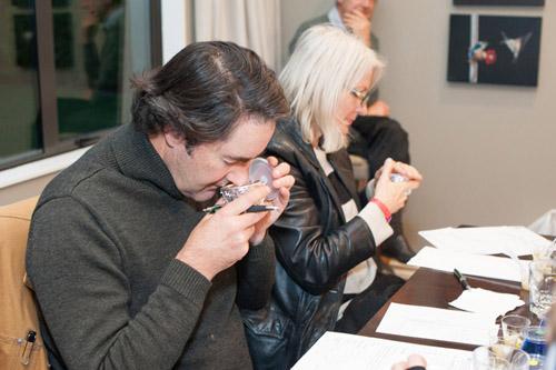 Guests smelling olive oil at Martinborough Olive Harvest Festival.
