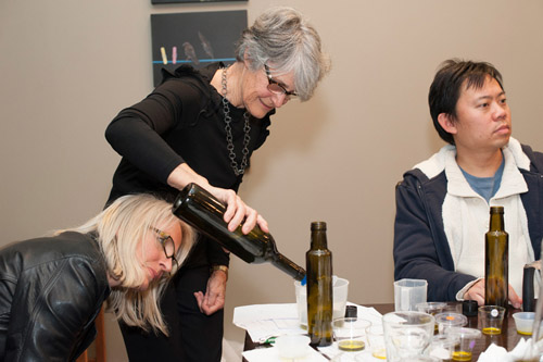Margaret Edwards helps blend individual oils for the class to take home.
