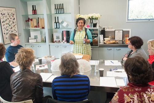 Nalini Baruch giving cooking demonstration at Lot 8, Martinborough.