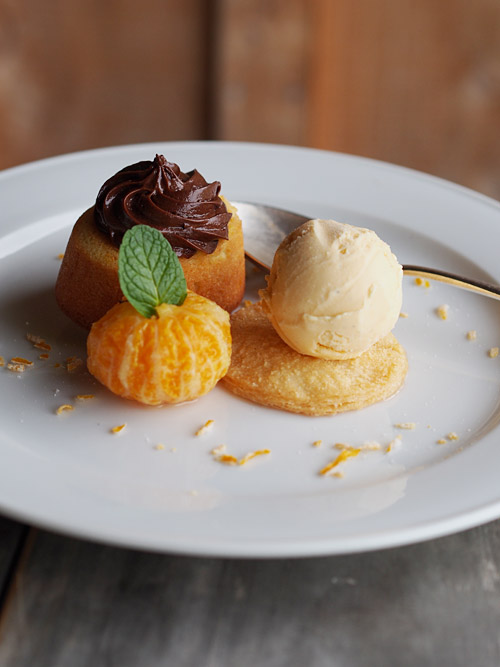 Little Orange Cakes with Chocolate Mousse, Poached Mandarins and Vanilla Ice Cream. Photo by