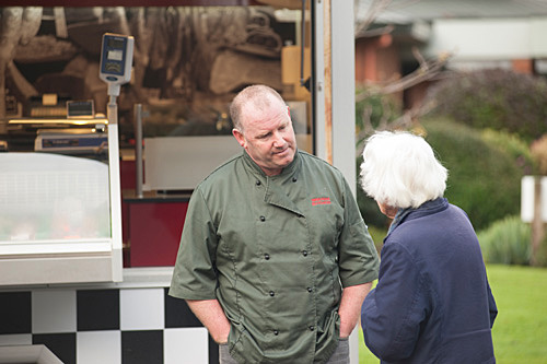 Andrew talking to customer about the Waikane Butcher mobile van.