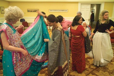 Women admiring saris at Dwali Festival, Wellington