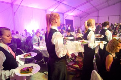 Waiters carrying food at Pinot Noir Conference, an event in Wellington celebrating New Zealand Pinot noir