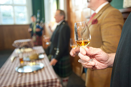Close up photo of hand holding whisky