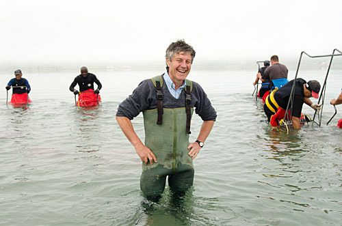 Portrait of Roger Belton, owner of Southern Clams, standing in sea.