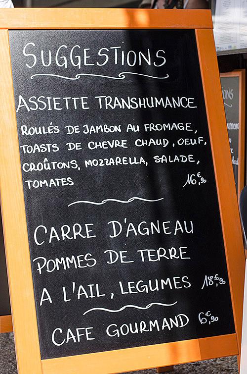 French restaurant sign advertising rack of lamb.