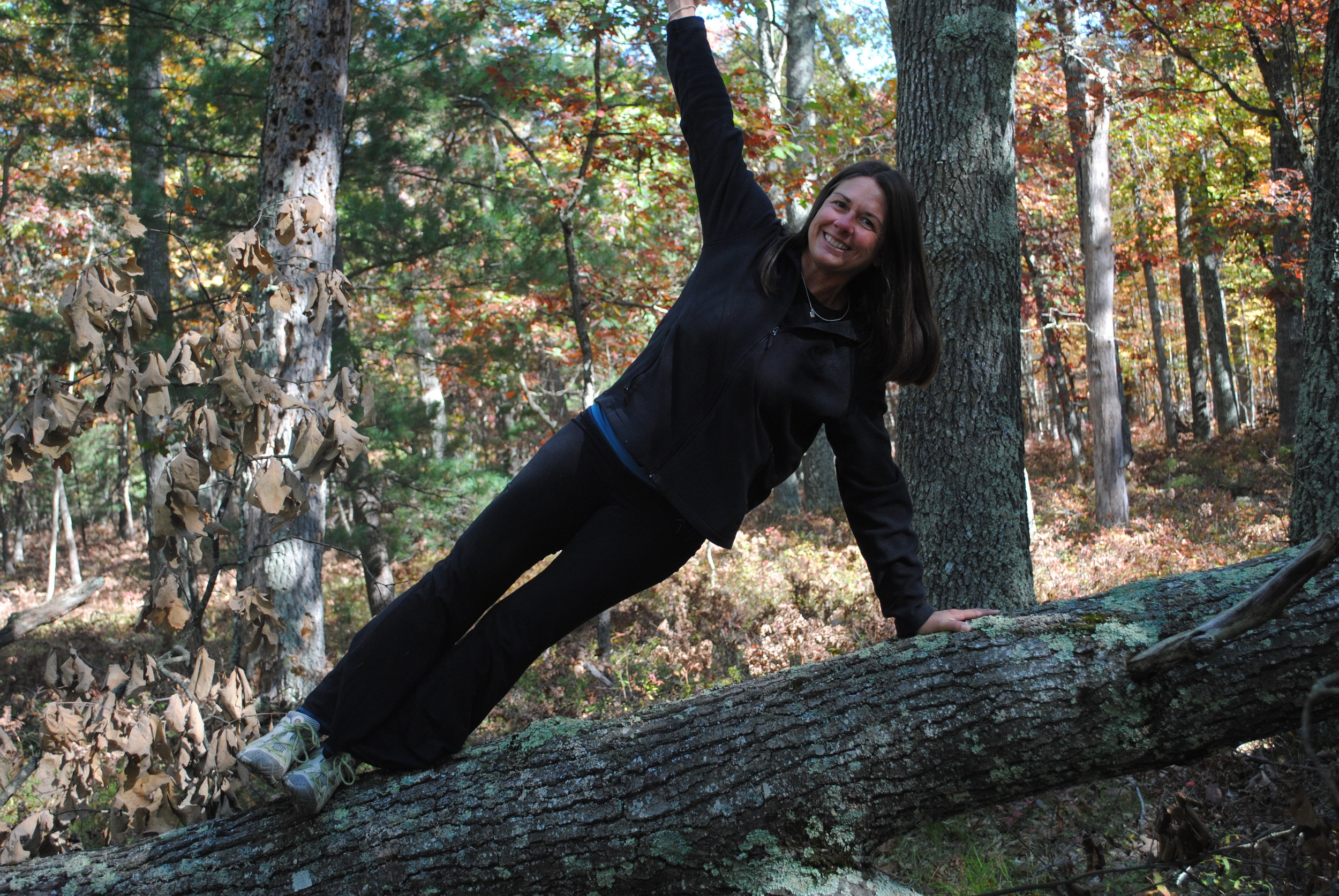 Side planking on a fallen tree. (Super challenging for your balance).
