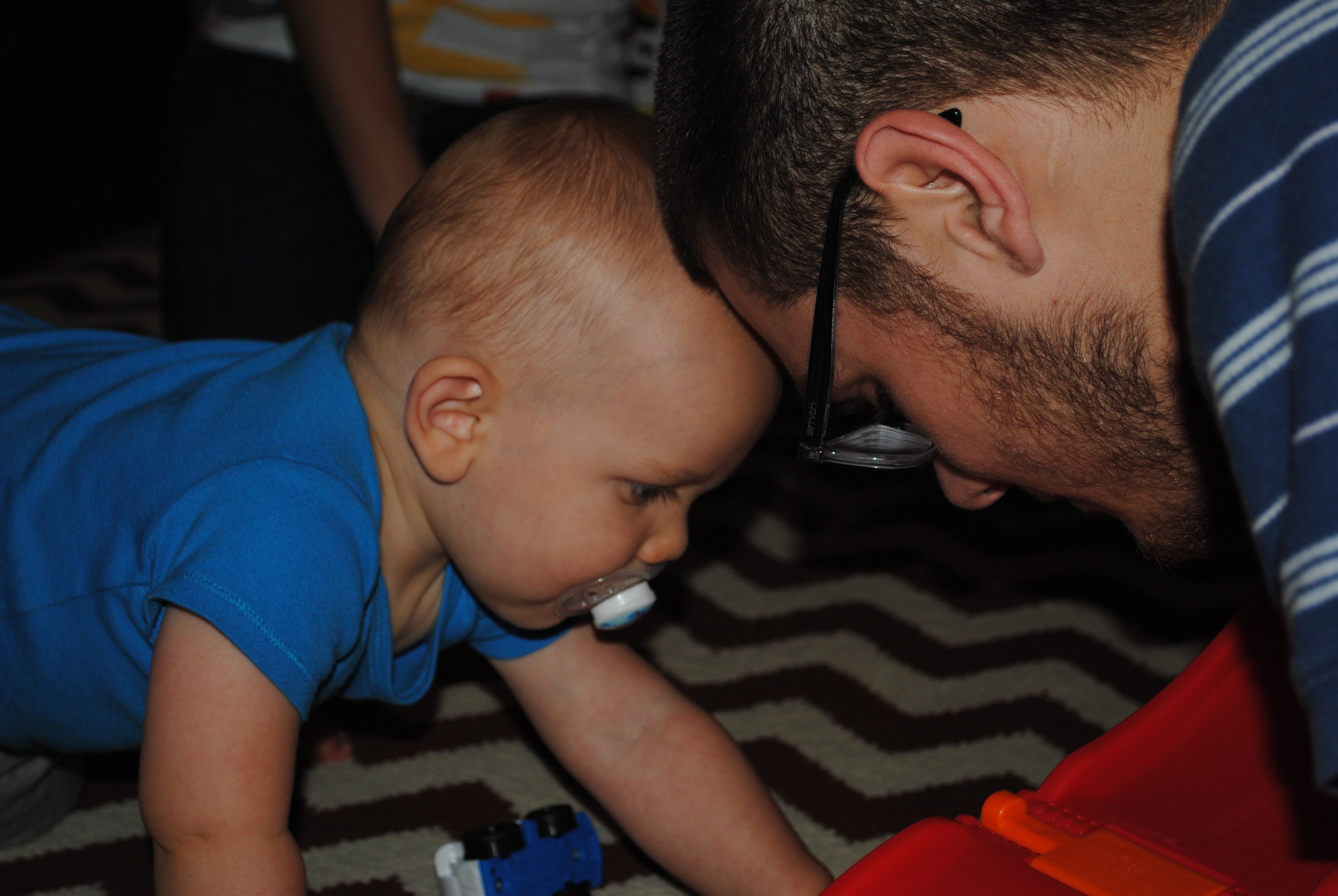 Putting their beautiful heads together. My son playing with his son. A treasured moment in time.