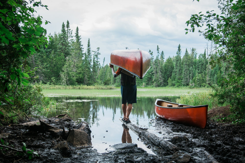 portaging-canoe-gaskin-winchell-portage-bwca-old-town-discovery-minnesota.jpg