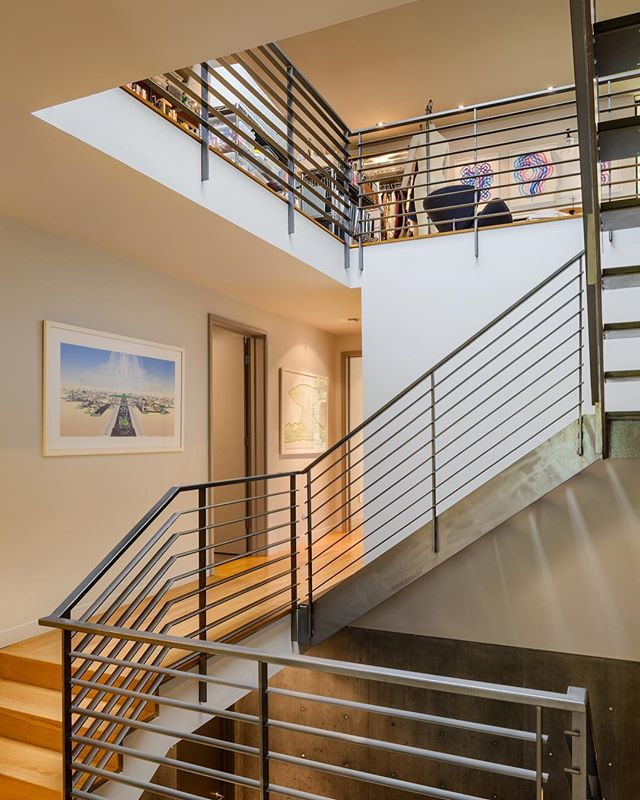 House of Planes stair to art studio.  Art by Benjamin Edwards, Leo Saul Berk and (upper level) Claude Zervas. . . . . #archinect #leoberk #seattlearchitects #architizer #modernhome #interiordesign #graymagazine #pnwarchitecture #dwell #dezeen