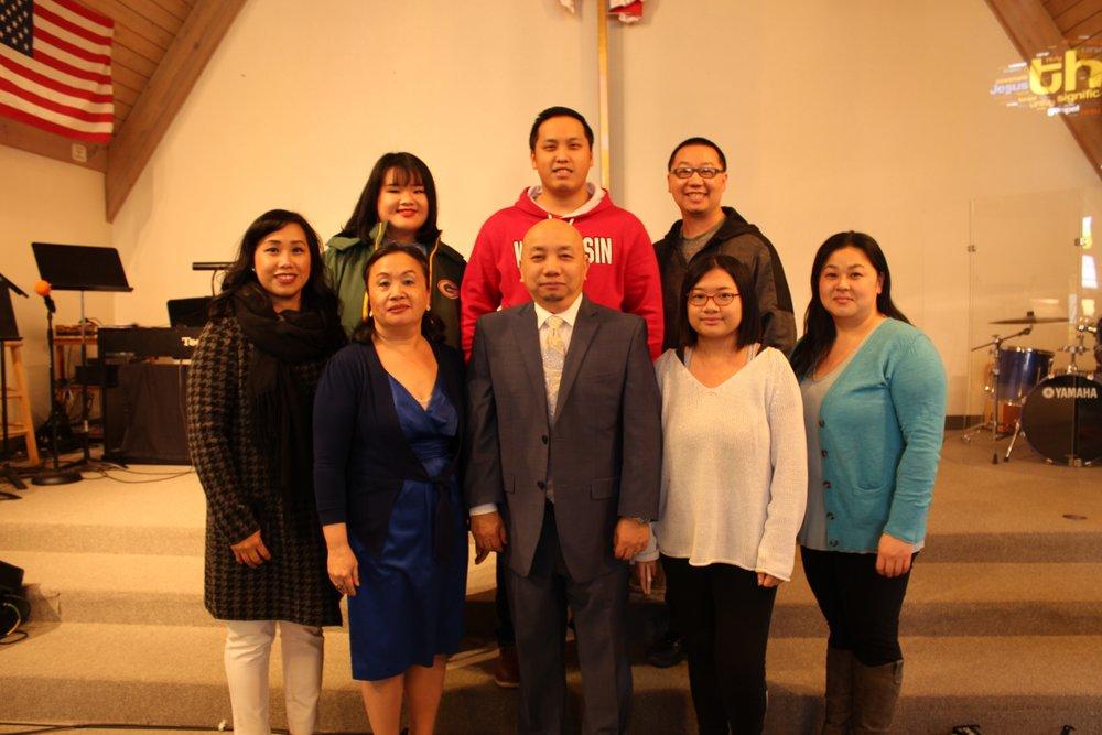 Staff from VHAC:  Front Row: N. Txoov Sawm Hawj (Coordinator), N. Xh. Tswv Tub, Xh. Tswv Tub, Alina, N. Vam Lauj.  Back Row: Ka Shia Vang, Michael Cha and Jacob Lo.