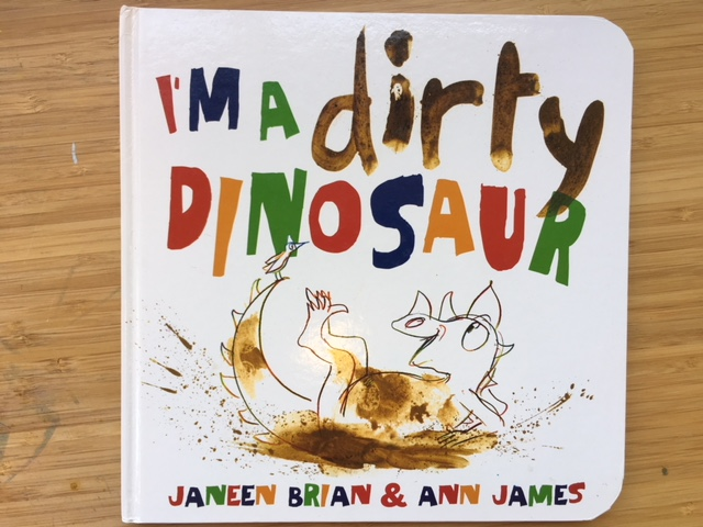 "September feature: - Nancy lead us in a ""dirty"" art activity that involved stamping toy dinosaurs in brown paint and ""walking"" them on large paper to create messy, muddy footprints. We then used a washing station to clean our dinosaurs and our hands."