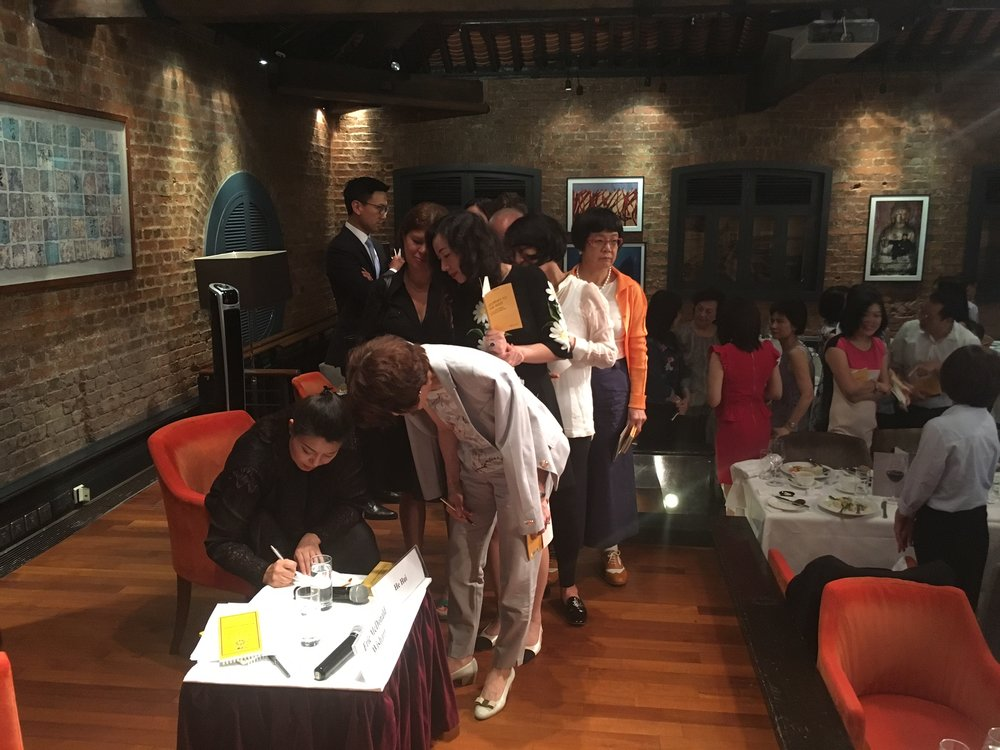 He Hui signing copies of  Journey to the West: He Hui, a Chinese soprano in the world of Italian opera.