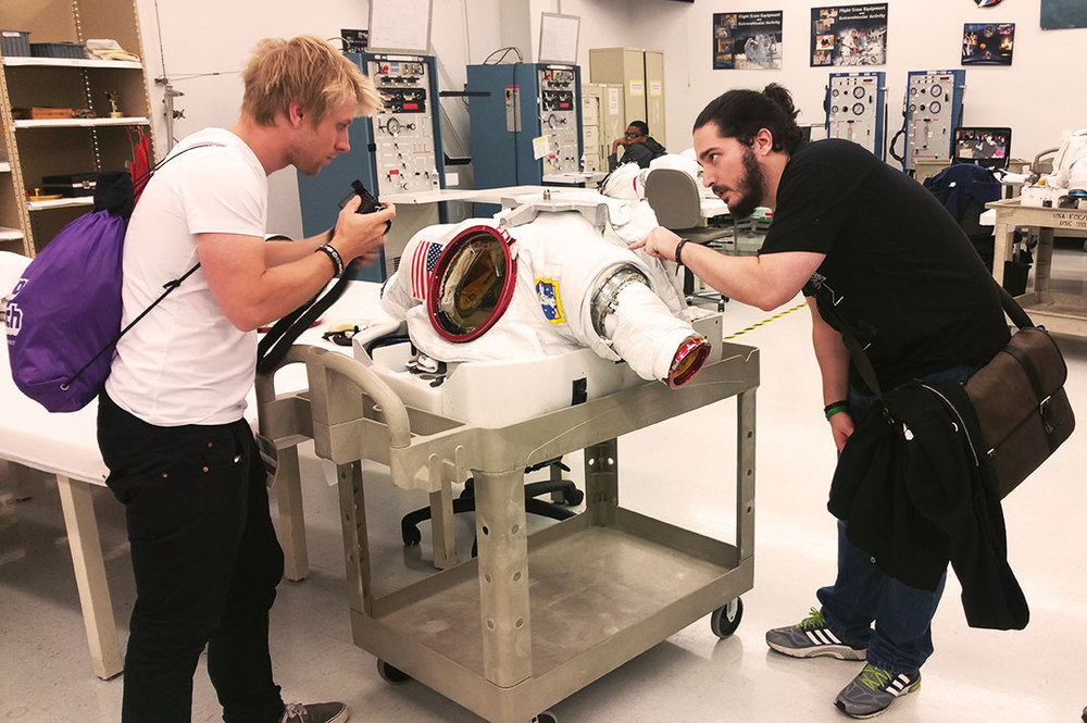 Team poking and prodding at the EMU suit used at NBL.jpg