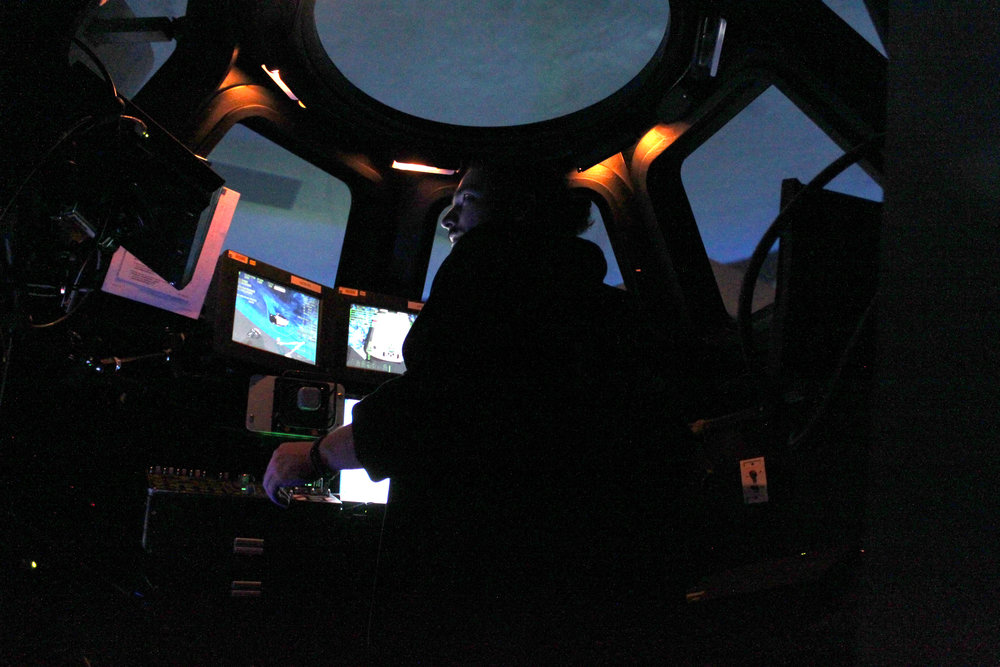 Team inside the cupola simulator.JPG