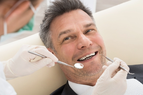 Older man receiving dental implant treatment at Titchfield Dental Health