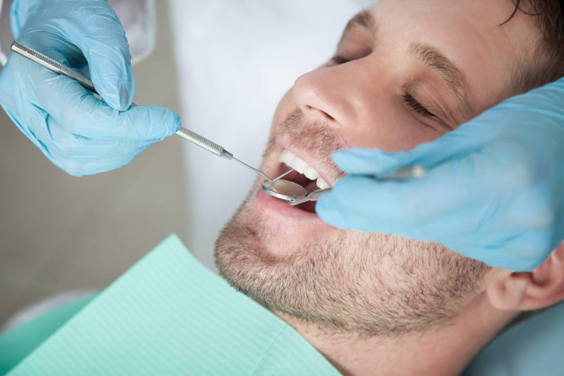 Close-up of man during his dental check-up at Titchfield Dental Health