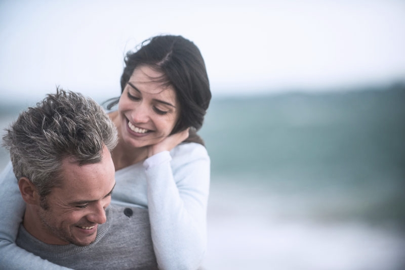 Happy couple on holiday after braces from Titchfield Dental Health