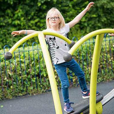 Girl playing on playground equipment in Heaton Close.jpg