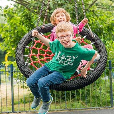 Kids playing on Tripod Basket Swing.jpg