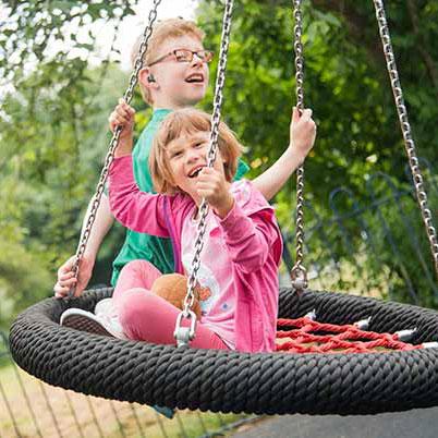 Kids playing on Basked Swing.jpg