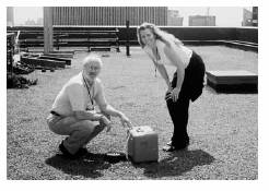 Julie Pullen   and colleague Jerry Allwine   install   an air sampler on top of a midtown Manhattan building during a field experiment in August   2005  .