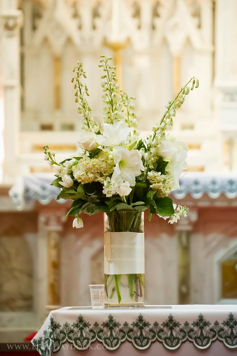 les fleurs : leah haydock photography : boston harbor hotel : winter wedding : white ceremony arrangements in glass cylinders